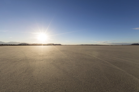 barren: Afternoon sun at El Mirage dry lake bed in Californias Mojave desert.