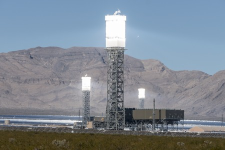 Ivanpah, California, USA - November 26, 2014:  Focused mirrors producing intense heat shimmers at the massive 392 megawatt Ivanpah solar power plant in Californias Mojave desert.