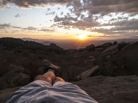los angeles county: Relaxed kicked backed sunset hiker legs.