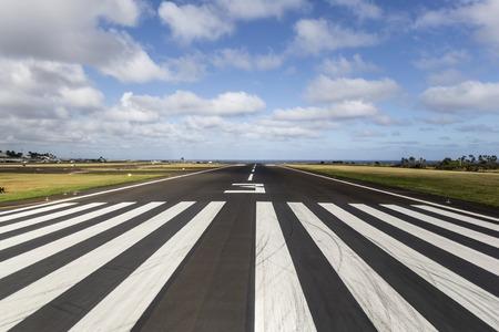 Tropical runway at a regional island airport in Hawaii.