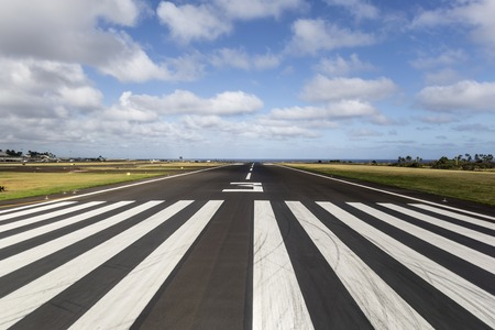 plane landing: Tropical runway at a regional island airport in Hawaii.