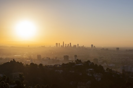 Los Angeles, California, USA - January 1, 2015:  Smoggy orange new years day sunrise above Hollywood and Downtown Los Angeles.