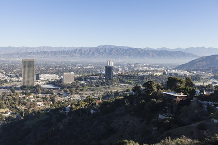 burbank: Los Angeles, California, USA - January 1, 2015:  New Years morning haze hovering behind Universal City Studios and Burbank near Los Angeles, California.
