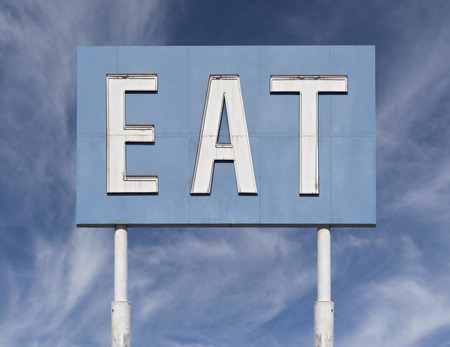 cirrus: Vintage blue eat sign with cirrus clouds. Stock Photo