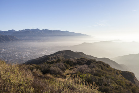 ca: Southern California misty morning hilltop view over Glendale, Eagle Rock and Altadena near Los Angeles.