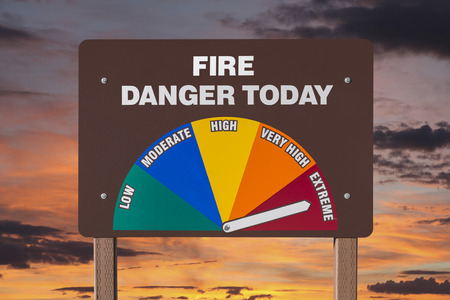 extreme danger: Extreme fire danger today sign isolated with orange sunrise. Stock Photo