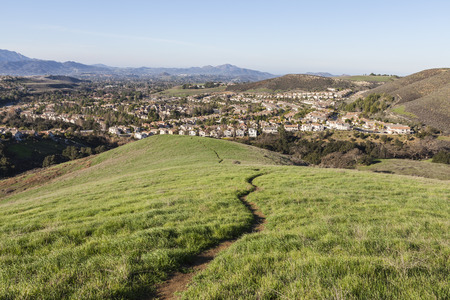 upscale: Suburban meadow hiking trail leading to upscale modern homes near Los Angeles in Thousand Oaks, California. Stock Photo