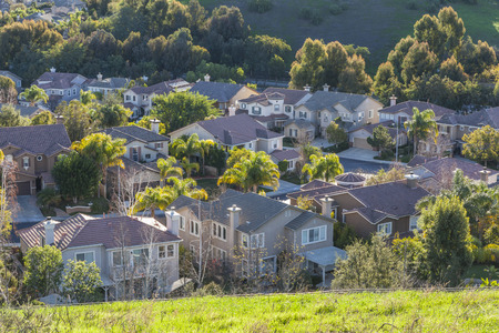 Southern California suburban homes in dawn light.