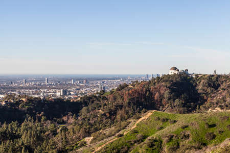 hollywood hills: Los Angeles, California, USA - January 14, 2015:  The famous Griffith Park Observatory with Hollywood and the pacific ocean in background.