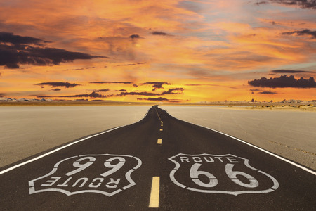 Romanticized rendition of Route 66 crossing a dry lake bed in the vast Mojave desert. Stok Fotoğraf