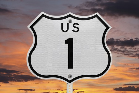 highway signs: US highway one sign with sunrise sky. Stock Photo