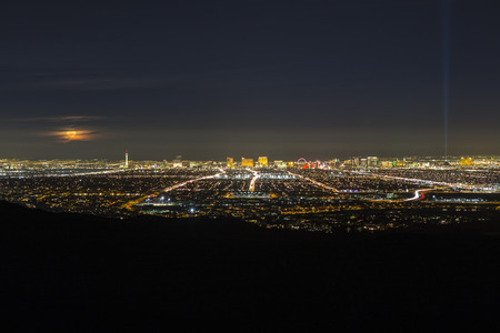 Las Vegas, Nevada, USA - February 4, 2015:  Full moon rising over the city of Las Vegas in southern Nevada.