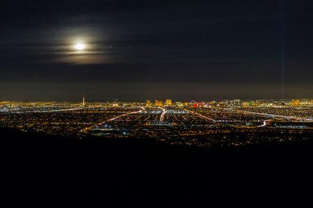 Las Vegas full moon rising cityscape skyline.