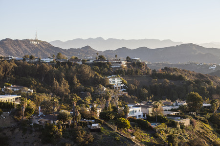 hollywood hills: Los Angeles, California, USA - January 1, 2015:  Hollywood Hills homes and the Hollywood Sign in the Santa Monica Mountains above Los Angeles.