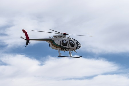 patrol: Las Vegas, Nevada, USA - February, 6,2015:  Las Vegas Metropolitan Police helicopter speeding by on patrol.