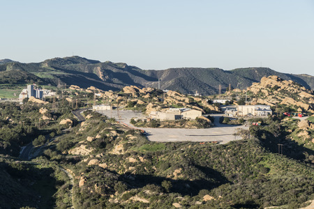 reactor: Simi Valley, California, USA - February 13, 2015:  View of buildings at the Santa Susana Field Laboratory from Sage Ranch Park near Los Angeles.  The site had a partial nuclear reactor meltdown in 1959.  It is a superfund site with future parkland designa Editorial