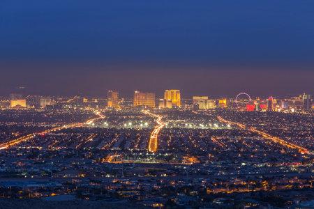 Las Vegas, Nevada, USA - February 3, 2015:  Las Vegas strip resorts glowing through early evening haze. Editorial