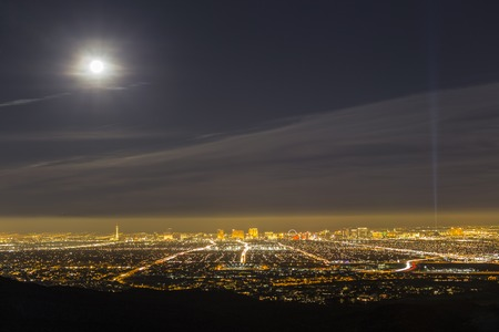 Las Vegas, Nevada, USA - February 3, 2015:  Full moon and early evening haze above the city of Las Vegas in southern Nevada.