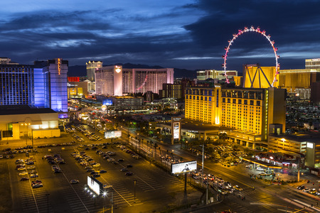 aerial views: Las Vegas, Nevada, USA - March 22, 2015:  Twilight at Las Vegas strip resorts and High Roller Ferris Wheel.