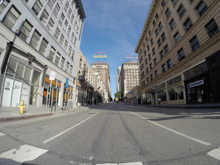 gritty: Los Angeles, California, USA - April 26, 2015:  Light weekend traffic on gritty 5th street in downtown Los Angeless historic core.
