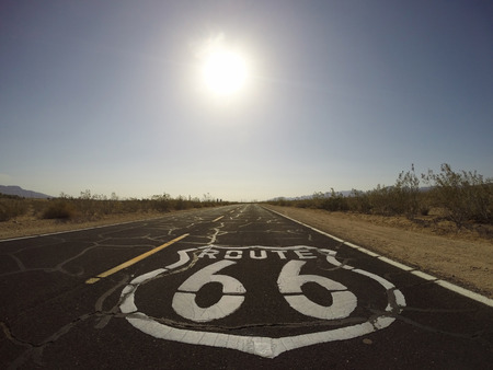 Historic Route 66 pavement sign in the heart of Californias Mojave desert. Stock Photo