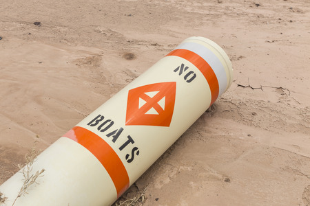 silt: No boats buoy laying on silt mud at drought damaged Lake Mead in Southern Nevada.