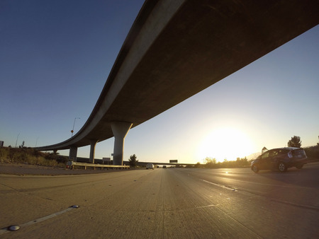 ronald reagan: Los Angeles California USA  May 3 2015:  118 and 405 freeway interchange at sunset in Los Angeless San Fernando Valley.