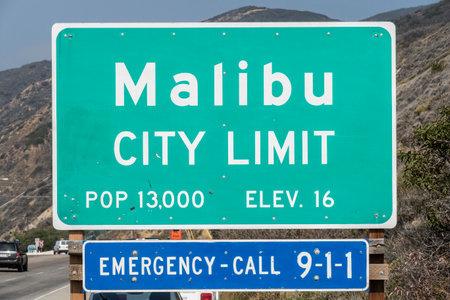 coastal: Malibu California USA  April 14 2015:  Malibu city limit sign on busy Pacific Coast Highway in Southern California.