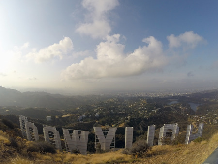 hollywood hills: Los Angeles California USA  April 22 2015:  Clearing morning clouds and fog below the famous Hollywood sign in Los Angeless popular Griffith Park.