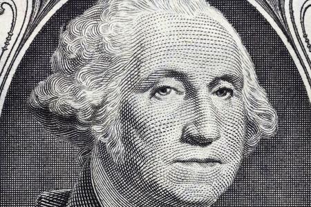 uno: Detalle macro de la cara de George Washington en los EE.UU. billete de un dólar.