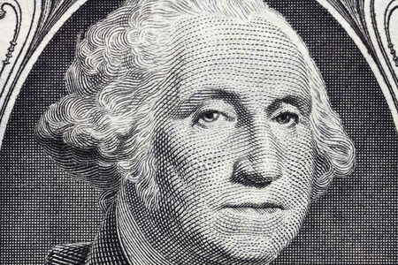 us dollar bill: Macro detail of George Washingtons face on the US one dollar bill.