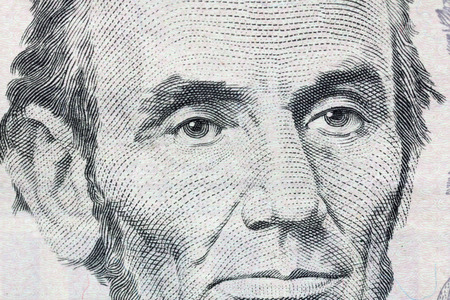 abe: Abraham Lincoln macro detail on US five dollar bill. Stock Photo