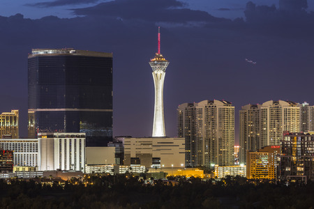 Las Vegas, Nevada, USA - June 10, 2015:  Stormy night sky behind the Stratosphere and Fontainebleau towers on the Las Vegas Strip. Redakční