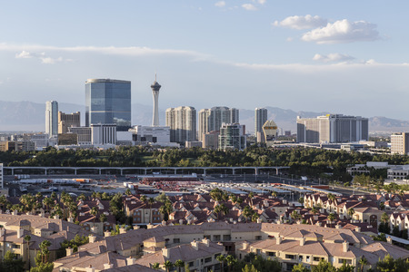 hotel casino: Las Vegas, Nevada, USA - June 10, 2015:  Sunny afternoon sky above condo complexes and the Stratosphere and Fontainebleau towers on the Las Vegas Strip.