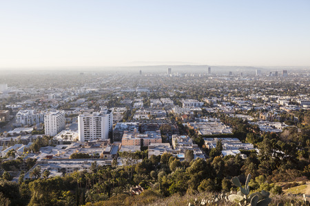 hollywood hills: Los Angeles, California, USA - January 1, 2015:  Smoggy haze filled morning sky above Hollywood and West Hollywood in Southern California.