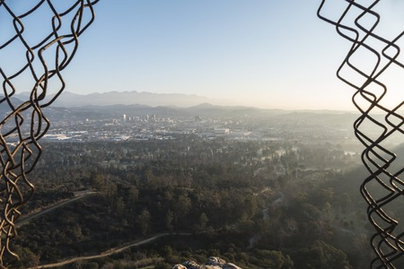 Smoggy hazy morning view of Los Angeles and Glendale from the top of Bee Rock in LAs Griffith Park.