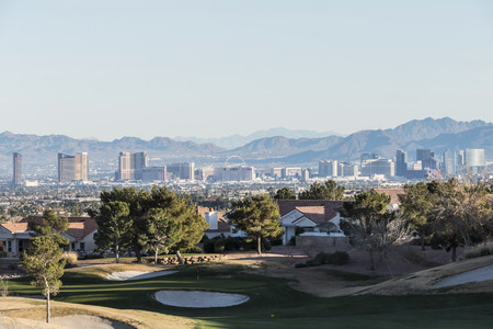 nevada: Las Vegas, Nevada, USA - December 27, 2014:  Clear winter sky above golf course homes and casino resort towers in Southern Nevada.