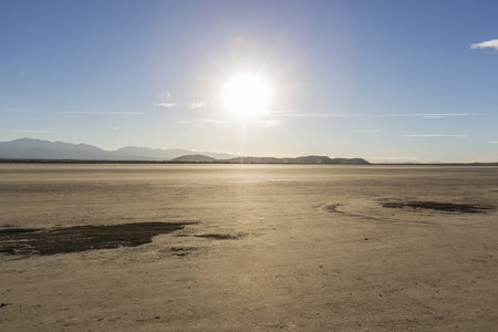 a mirage: Afternoon sun at El Mirage dry lake in Californias Mojave desert.