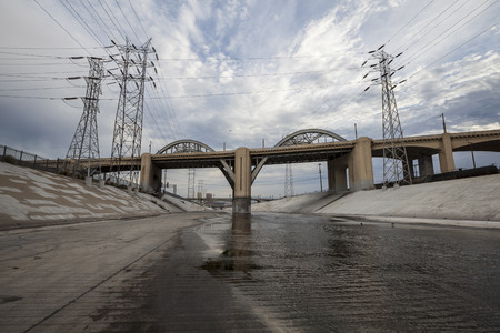 The Los Angeles River and Historic 6th Street Bridge near downtown Los Angeles.