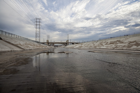 gritty: Overcast clouds over the gritty Los Angeles river in Southern California.