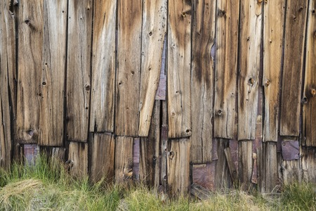 ghost town: Funky old wood wall at Bodie ghost town in Californias Sierra Nevada mountains. Stock Photo