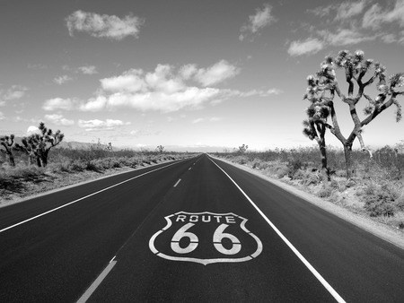 Route 66 crossing the Mojave desert black and white. Stock Photo