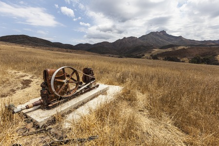 water pump: Vintage abandoned water pump in the Santa Monica Mountains area of drought stricken Southern California. Stock Photo