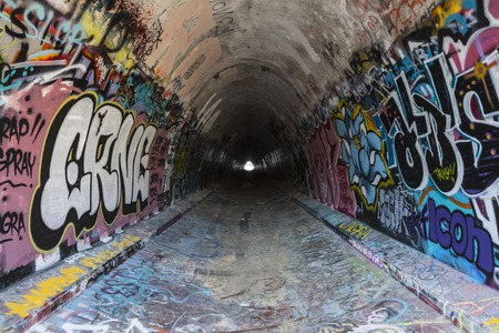Simi Valley, California, USA - August 1, 2015:  Urban graffiti tunnel under the 118 Freeway near Los Angeles. Editorial