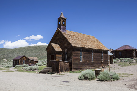 ghost town: Wild west ghost town church and other buildings at Bodie State Historic park in California.