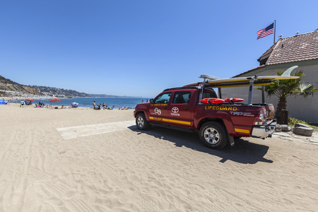 lifeguard: Malibu, California, USA - August 15, 2015:  Los Angeles County Lifeguard truck on the sand at Topanga State Beach in Santa Monica Bay.