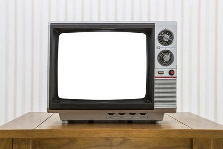 Vintage draagbare televisie op oude ambachtsman stijl tafel met uitgesneden scherm Stockfoto