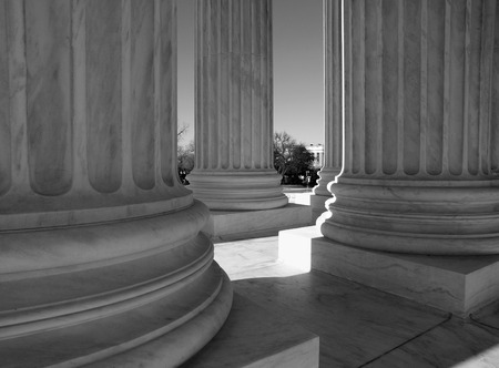 untied: United States Supreme Court columns in black and white.