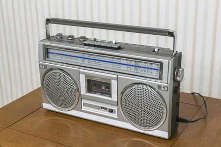 boombox: Old boom box radio cassette recorder on wood table. Stock Photo