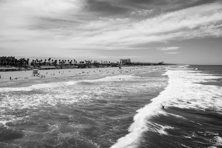 orange county: Summer surf at Huntington Beach California in black and white.